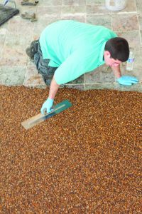 Worker Applying Nature Stone Flooring